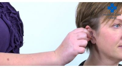 How to help someone insert their moulded hearing aid Thumbnail